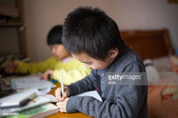 chinese boy and girl study at home