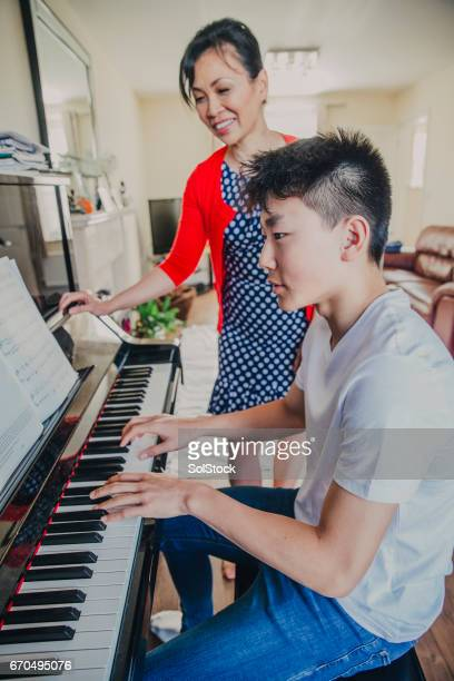 Chinese Boy getting taught Piano!