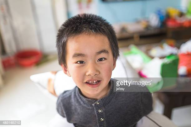 chinese boy  playing with pillow