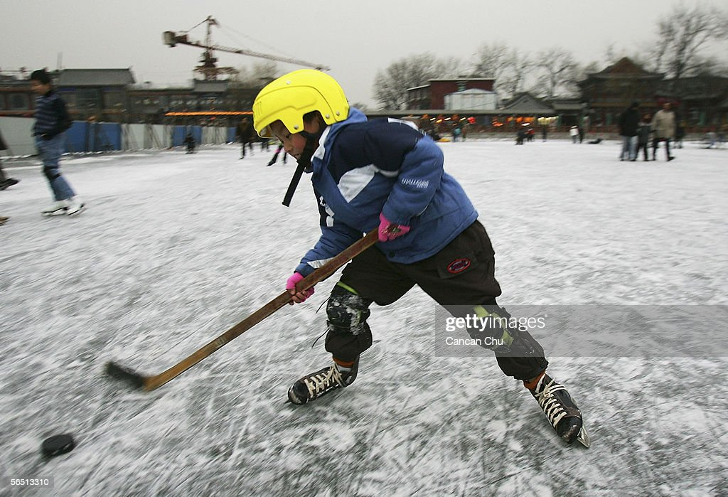 A Chinese boy plays ice hockey on the frozen Shichahai Lake on January 3, 2006 in Beijing, China. Shichahai Lake is a popular place for winter sport and entertainment in Beijing.