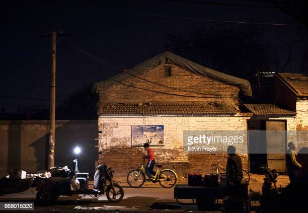 Chinese boy rides a bike share in an old neighbourhood on March 29 2017 in Beijing China The popularity of bike shares has exploded in the past year...