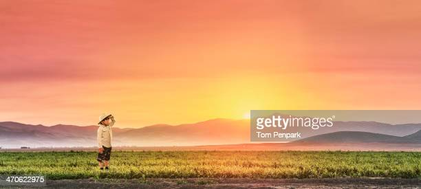 Chinese boy standing in rural field