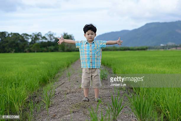 Chinese boy standing in the field