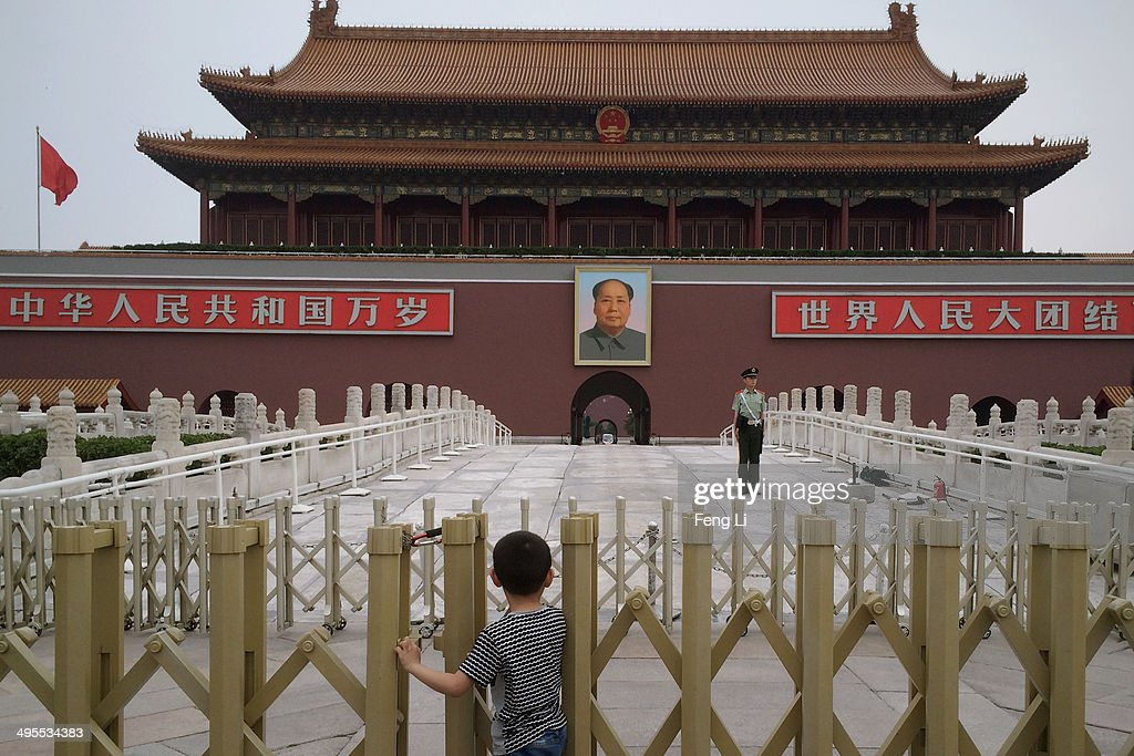 A Chinese boy waits for the customary ceremony of lowering flag in Tiananmen Square on June 4, 2014 in Beijing, China. Twenty-five years ago on June 4, 1989 Chinese troops cracked down on pro-democracy protesters and in the clashes that followed scores were killed and injured.