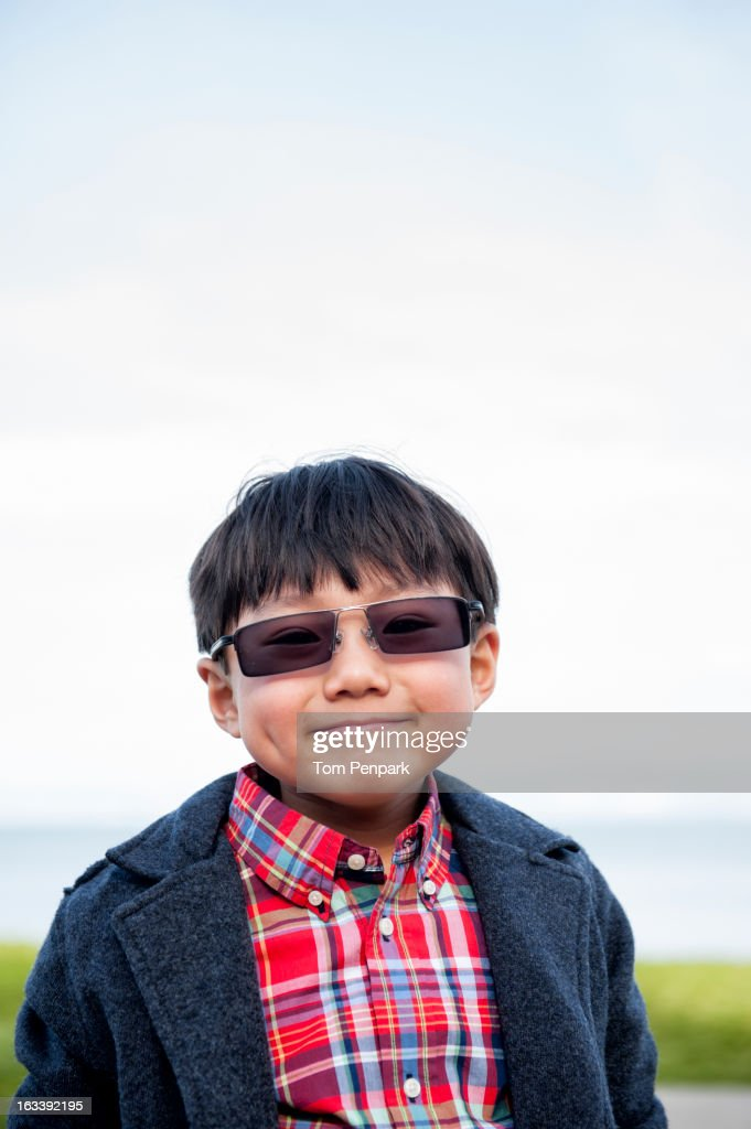 Chinese boy wearing sunglasses outdoors : Stock Photo
