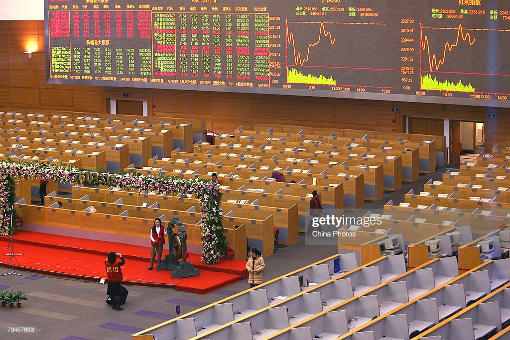 A Chinese broker poses for a photo inside the Shanghai Stock Exchange on March 1, 2007 in Shanghai, China. China's stock market experienced its sharpest daily fall in 10 years February 27, 2007 in spite of the premier's pledges to develop the capital market. The benchmark Shanghai Composite Index fell 83.88 points, or 2.91 per cent to 2,797.19 today.
