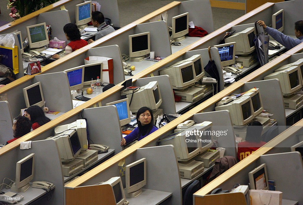 Chinese brokers work inside the Shanghai Stock Exchange on March 1, 2007 in Shanghai, China. China's stock market experienced its sharpest daily fall in 10 years on February 27, 2007 in spite of the premier's pledges to develop the capital market. The benchmark Shanghai Composite Index fell 83.88 points, or 2.91 per cent to 2,797.19 today.