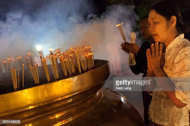 BODHGAYA BIHAR INDIA BODHGAYA BIHAR INDIA Chinese buddhist pilgrims praying at night in Mahabodhi temple in Bodh Gaya Bihar India 'Great Awakening...