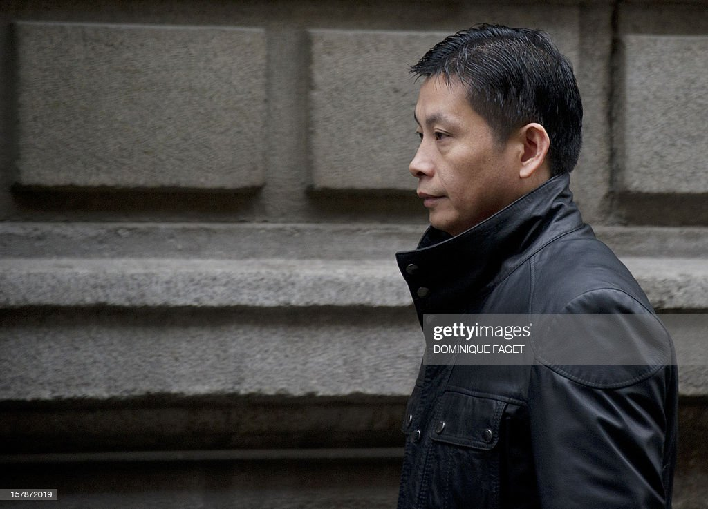 Chinese businessman and art gallery owner Gao Ping, who is free on bail with conditions arrives at the court in Madrid on December 7, 2012. Gao Ping is suspected of leading a massive money-laundering gang in Spain. AFP PHOTO/ DOMINIQUE FAGET