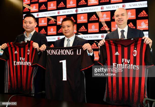 Chinese businessman and new owner of the AC Milan football club Yonghong Li poses with Italian businessman Marco Fassone and Rossoneri Sport...