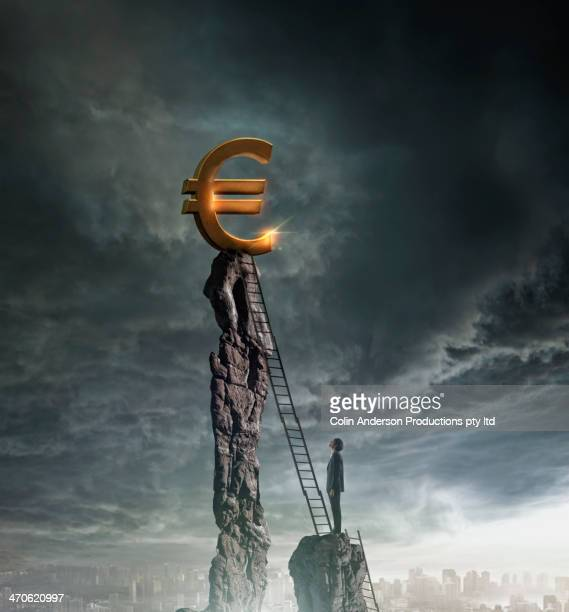 Chinese businessman climbing letter to Euro sign