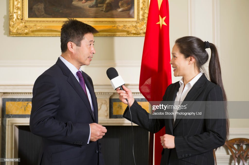 Chinese businessman giving interview : Stock Photo