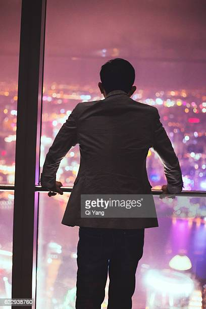 Chinese businessman looking out the window