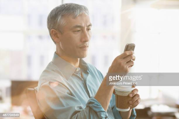 Chinese businessman using cell phone