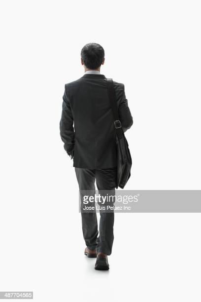 Chinese businessman walking