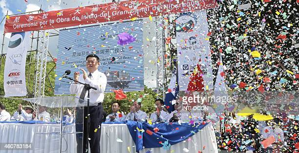 Chinese businessman Wang Jing of HKND Group applauds next to members of the Nicaraguan government during the inauguration of the works of an...