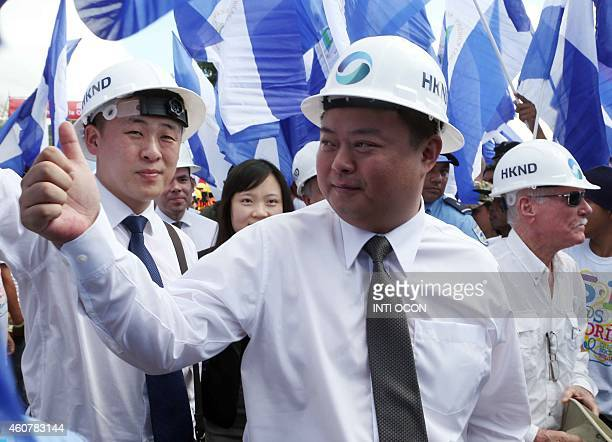 Chinese businessman Wang Jing of HKND Group gives the thumb up during the inauguration of the works of an interoceanic canal in Tola some 3 km from...