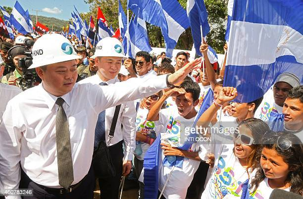 Chinese businessman Wang Jing of HKND Group greets members of the Sandinista National Liberation Front during the inauguration of the works of an...