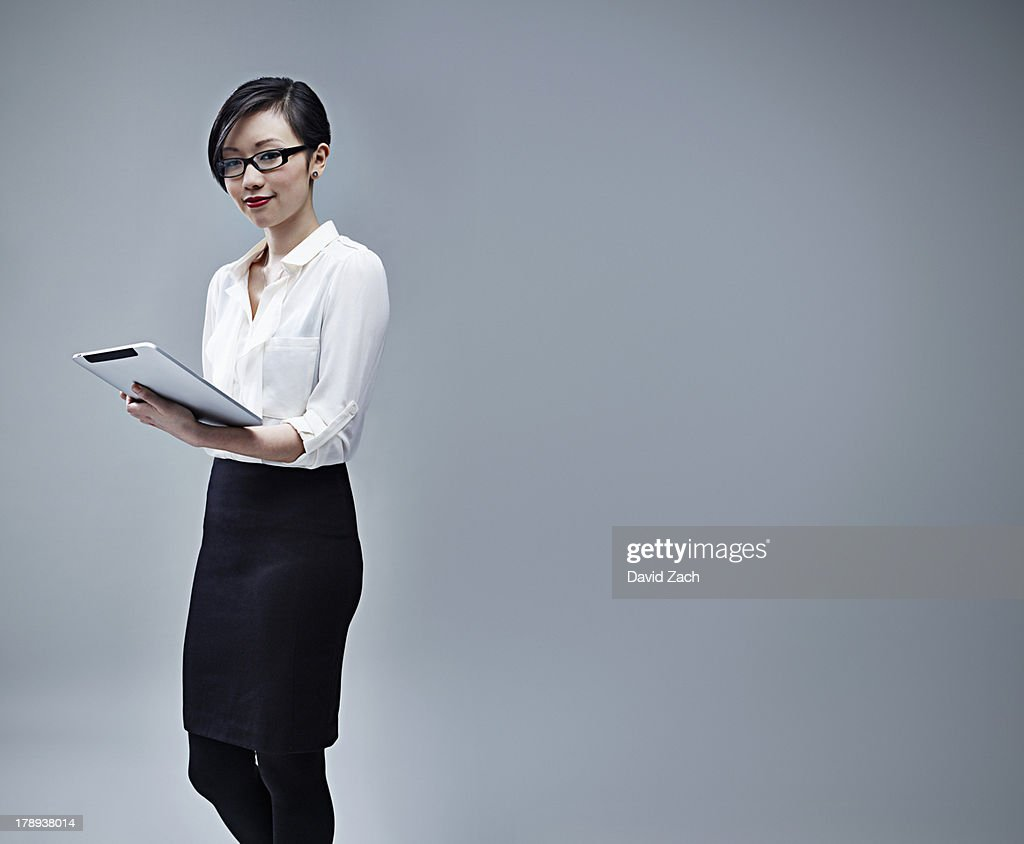 Chinese businesswoman holding digital table : Stock Photo