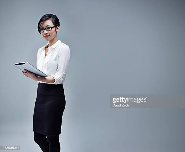 Chinese businesswoman holding digital table