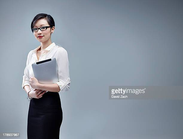 Chinese businesswoman holding digital tablet