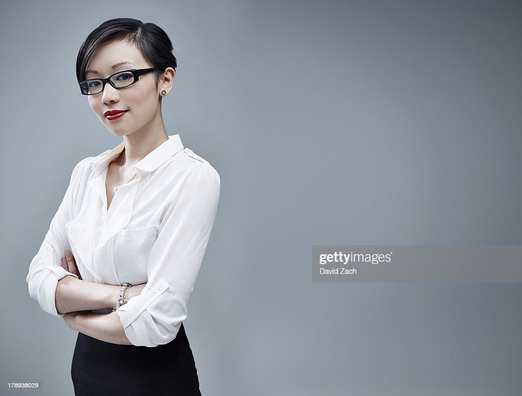 Chinese businesswoman looking at camera, portrait : Stock Photo