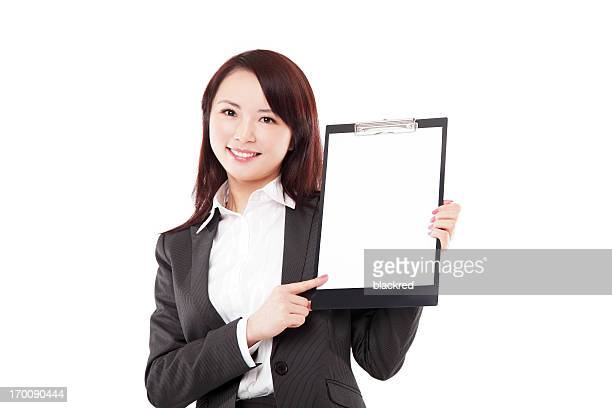 Chinese Businesswoman Presenting with Clipboard Smiling on White Background