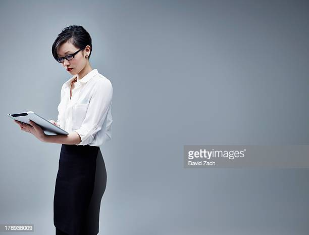 Chinese businesswoman using digital tablet