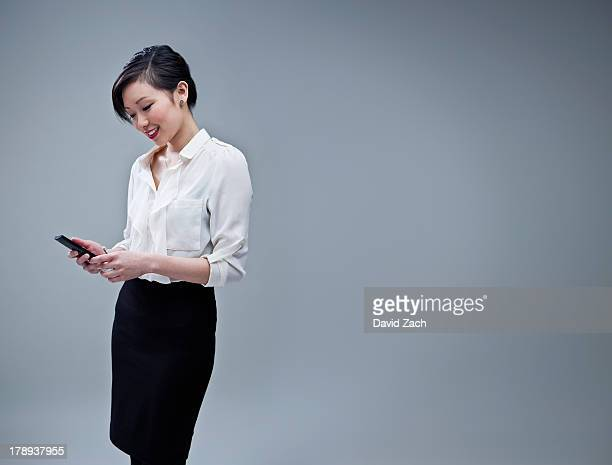 Chinese businesswoman using mobile phone, portrait