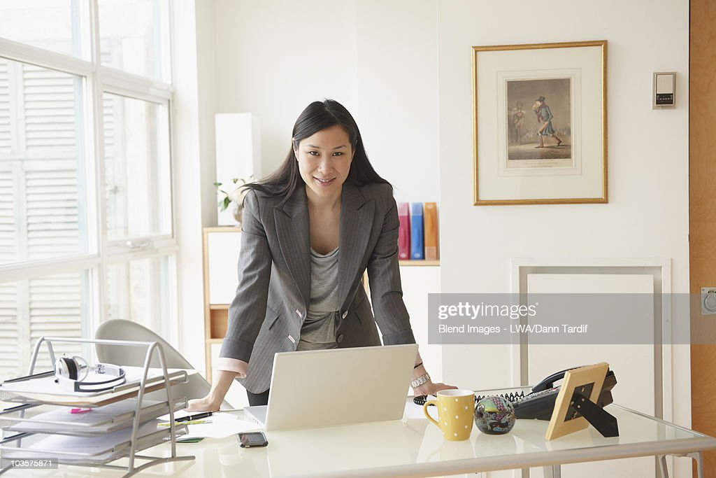 Chinese businesswoman working at desk : Stock Photo
