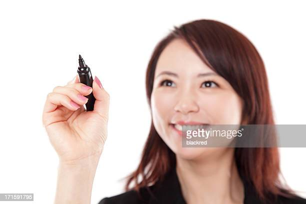 Chinese Businesswoman Writing with Marker on White Background