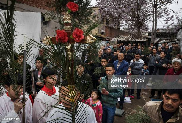 Chinese Catholic altar boys hold palm fronds in a procession for the Palm Sunday Mass during the Easter Holy Week at an 'underground' or 'unofficial'...