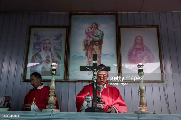 Chinese Catholic Priest Dong Guanhua leads a Palm Sunday Mass during the Easter Holy Week at an 'underground' or 'unofficial' church on April 9 2017...