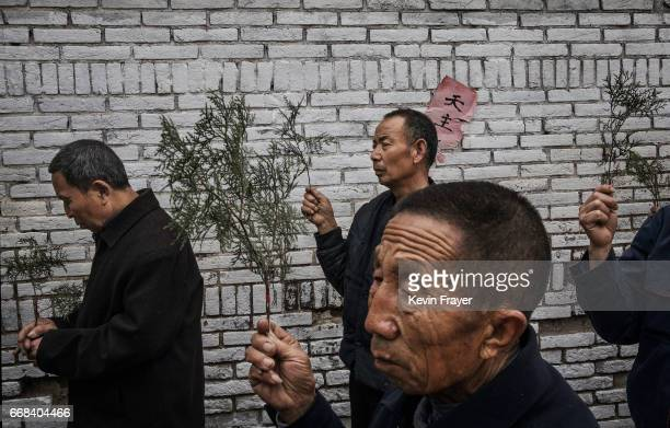 Chinese Catholic worshippers carry palm fronds as they pray at the Palm Sunday Mass during the Easter Holy Week at an 'underground' or 'unofficial'...