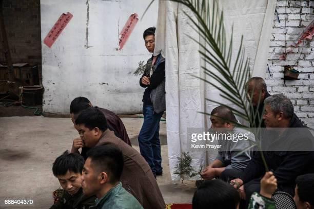 Chinese Catholic worshippers listen at a Palm Sunday Mass during the Easter Holy Week at an 'underground' or 'unofficial' church on April 9 2017 near...