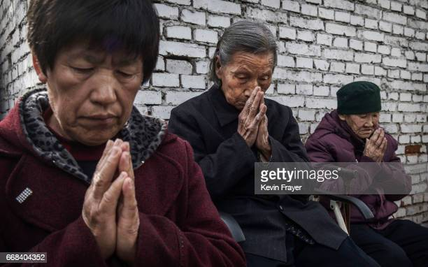 Chinese Catholic worshippers pray at the Palm Sunday Mass during the Easter Holy Week at an 'underground' or 'unofficial' church on April 9 2017 near...