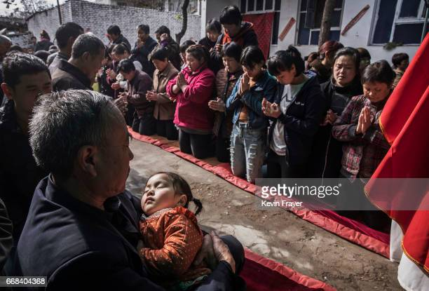 A Chinese Catholic worshippers wait to take communion at the Palm Sunday Mass during the Easter Holy Week at an 'underground' or 'unofficial' church...
