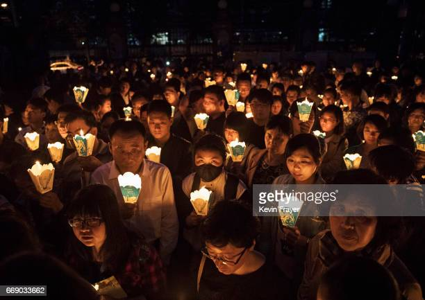 Chinese Catholics hold candles at a mass on Holy Saturday during Easter celebrations at the government sanctioned West Beijing Catholic Church on...