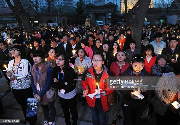 Chinese Catholics pray as they attend an Easter service at the historic South Cathedral in Beijing on April 7 2012 Easter ceremonies traditionally...