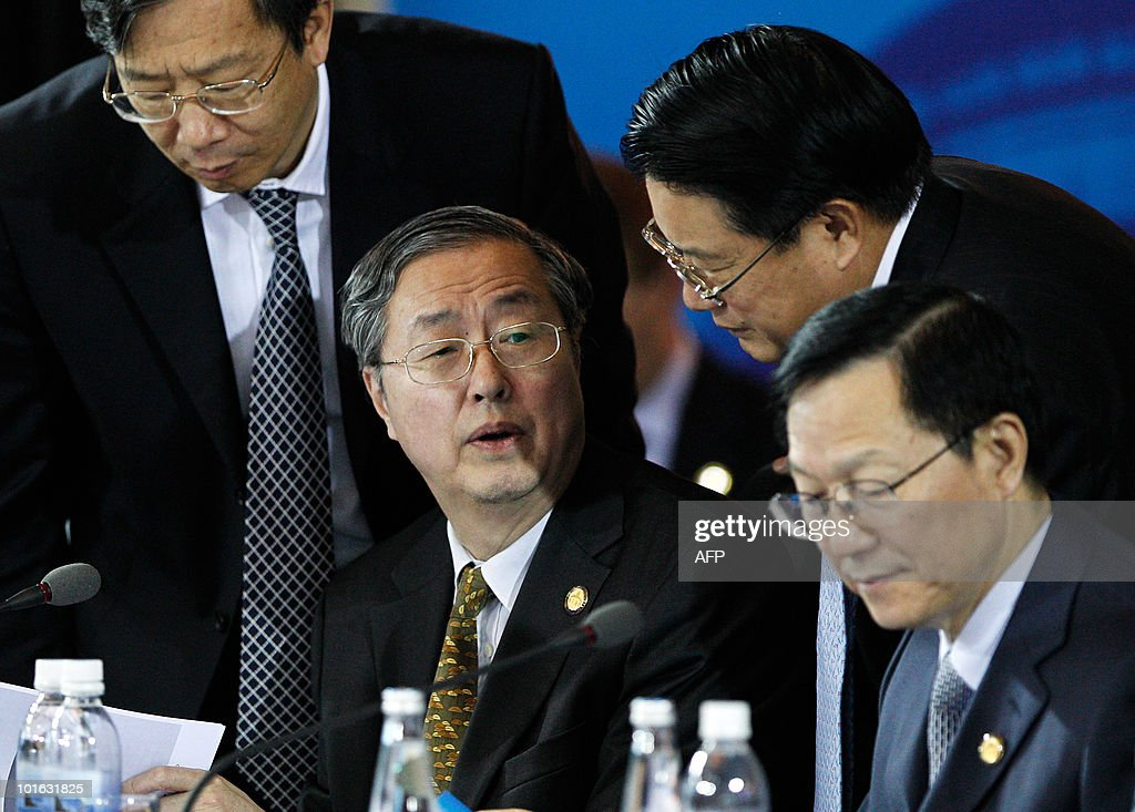 Chinese Central Bank Governor Zhou Xiaochuan (C) talks with his officlals while Finance Minister Xie Xuren (R) looks over a document during the G20 Finance Ministers and Central Bank Governors Meeting in Busan on June 5, 2010. Finance ministers from the world's leading nations sought to narrow differences on key banking reforms, wrapping up a two-day meeting aimed at safeguarding fragile economic recovery.