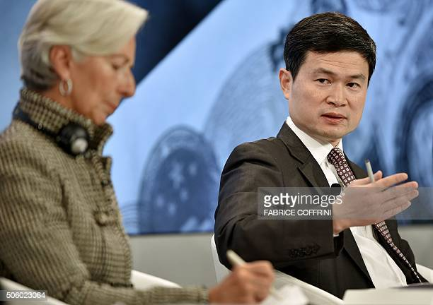 Chinese Central Leading Group for Financial and Economic's Fang Xinghai gestures next to International Monetary Fund Managing Director Christine...