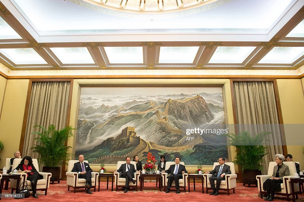 Chinese Chairman of the National People's Congress Zhang Dejiang (3rd R) and Chinese Foreign Minister Wang Yi (2nd R) meet with France's President Francois Hollande (3rd L) and French Foreign Minister Laurent Fabius (2nd L) at the Great Hall of the People in Beijing on April 26, 2013. Hollande arrived in Beijing on April 25 for a two-day China trip aimed at boosting exports to China, with hopes that deals can be reached over the sale of aircraft and nuclear power. AFP PHOTO / POOL / BERTRAND LANGLOIS