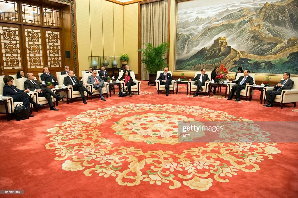 Chinese Chairman of the National People's Congress Zhang Dejiang (2nd R) and Chinese Foreign Minister Wang Yi (R) meet with France's President Francois Hollande (3rd R), French Foreign Minister Laurent Fabius (4th R), French special envoy Martine Aubry (L) and former French prime minister Jean-Pierre Raffarin (4th L)at a meeting at the Great Hall of the People in Beijing on April 26, 2013. Hollande arrived in Beijing on April 25 for a two-day China trip aimed at boosting exports to China, with hopes that deals can be reached over the sale of aircraft and nuclear power.