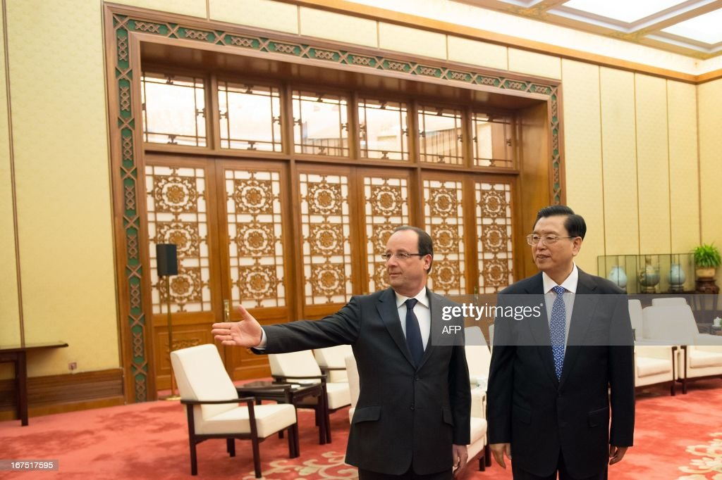 Chinese Chairman of the National People's Congress Zhang Dejiang (R) welcomes France's President Francois Hollande at the Great Hall of the People in Beijing on April 26, 2013. Hollande arrived in Beijing on April 25 for a two-day China trip aimed at boosting exports to China, with hopes that deals can be reached over the sale of aircraft and nuclear power.