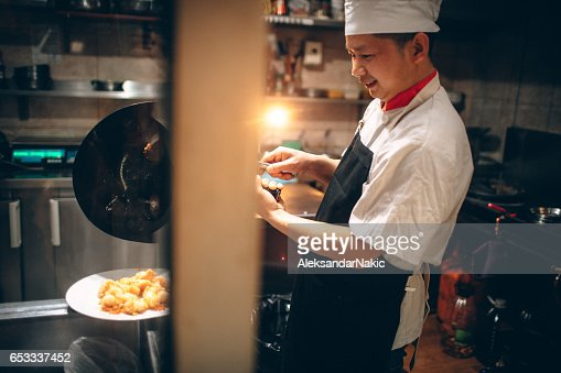 Chinese chef cooking : Bildbanksbilder