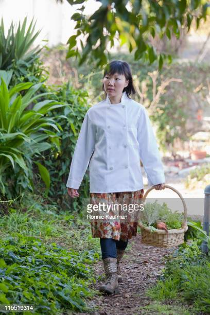 Chinese chef gathering vegetables