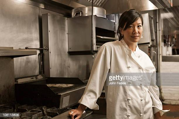 Chinese chef standing in commercial kitchen