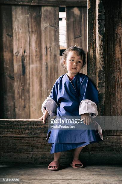 Chinese Child in traditional work clothes