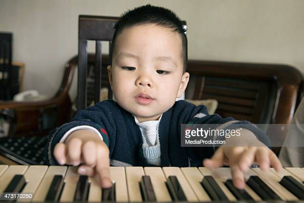 Chinese Child learning to play piano