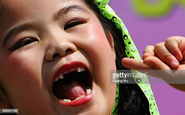 A chinese child sings a song during a celebration to mark the International Children's Day on June 1 2005 in Beijing China The International...